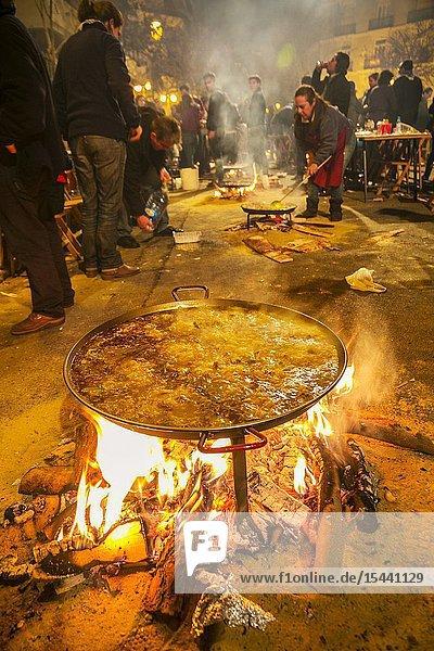 Fallas festival. Paella contest. Preparing to make a paella. Rice dish  traditional Valencian food. Valencia. Valencian Community. Spain.