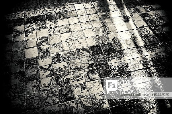 Pavement of ancient tiles with sunshine refajos in a church. Hermitage of our Lady of Gracia  Mahon Menorca  Balearic Islands  Spain  Europe.