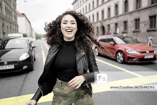 Buoyant woman at street  in Munich  Germany