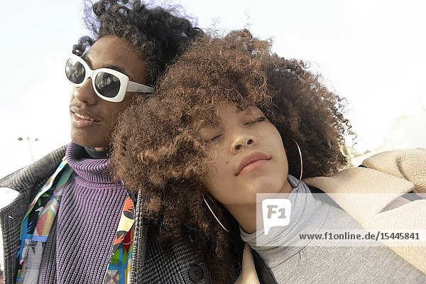 Young fashionable mixed-race couple resting on each other  in Paris  France