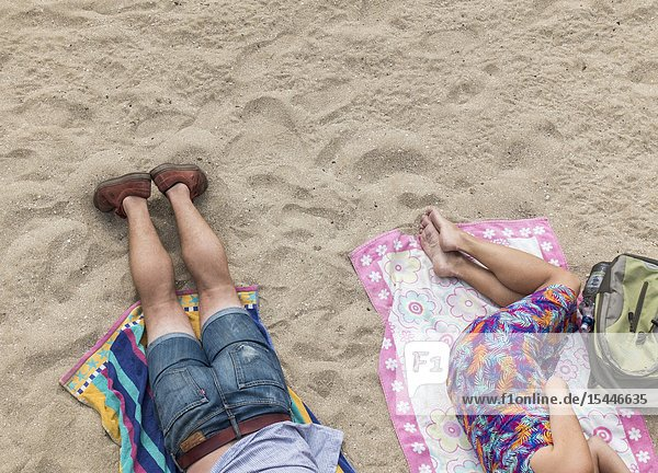 Man and woman sleeping on beach in Las Palmas  Gran Canaria  Canary Islands  Spain.