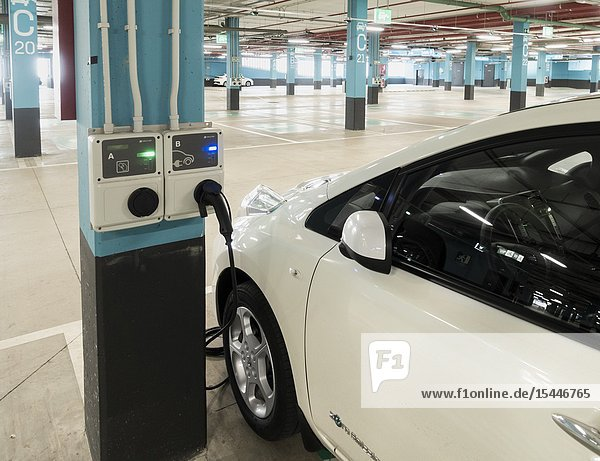 Electric car charging point in shopping centre car park on Gran Canaria  Canary Islands  Spain.