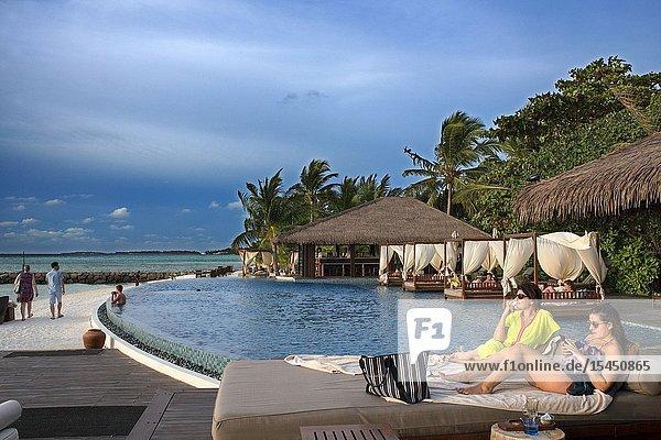 Swimming pool and restaurant in The Residence Hotel and Resort  Gaafu Alifu Atoll. Maldives Islands.