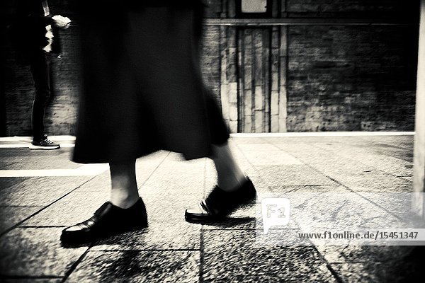 Closeup of the feet of an old lady walking. Bucharest  Romania  Europe.