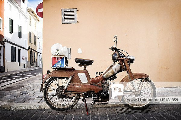 Mobylette G.A.C. parked on a street. Mahon  Baleares  Spain  Europe.