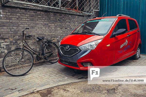 Three-wheeled car in traditional hutong residential area in Dongcheng district of Beijing  China.