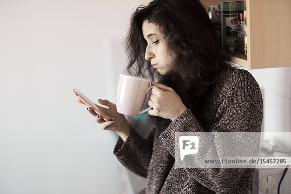 Young woman using smartphone in morning