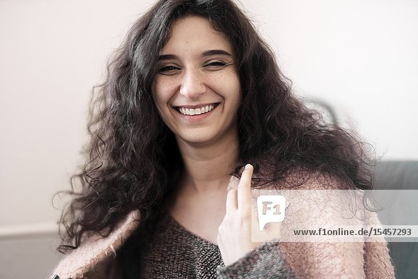 Young smiling woman at home  in Cottbus  Brandenburg  Germany