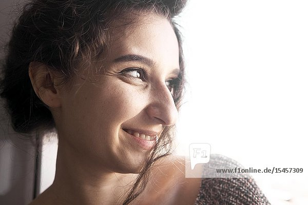 Young woman grinning