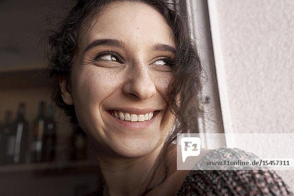Headshot of happy woman at home
