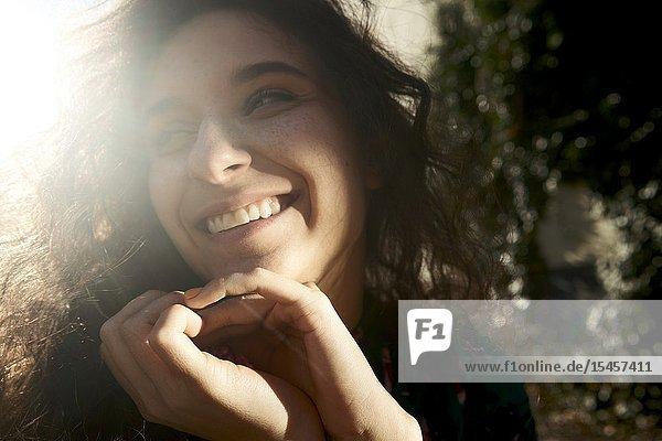 Smiling woman peering aside