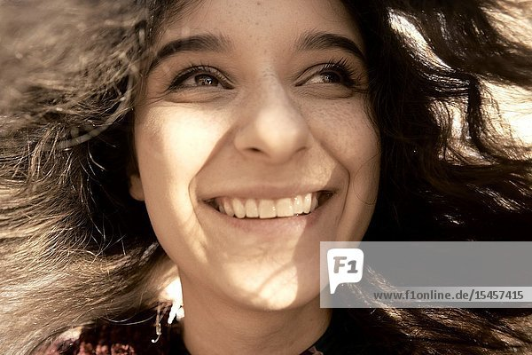 Young happy unvarnished woman in sunlight