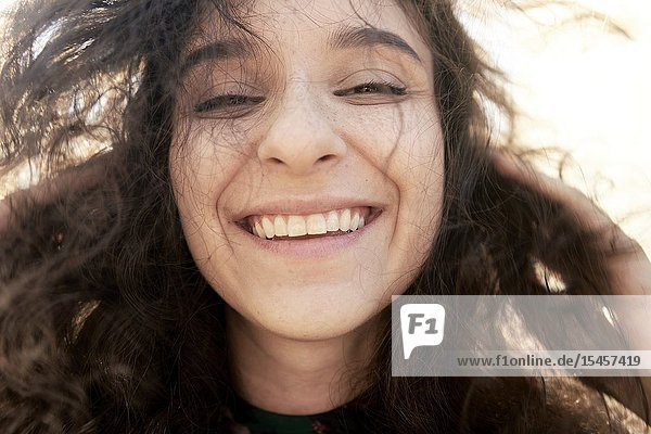 Happy authentic woman laughing