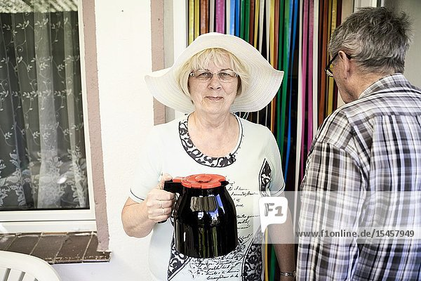 Senior woman with coffee pot ready for afternoon break