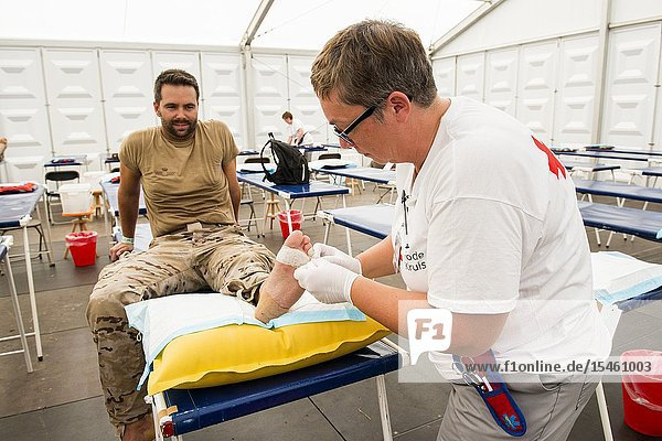 Nijmegen  Breukelen  Netherlands. Red Cross medical staff taking care of blisters and injuries at the first aid post during the Nijmegen Four Day March 2017.