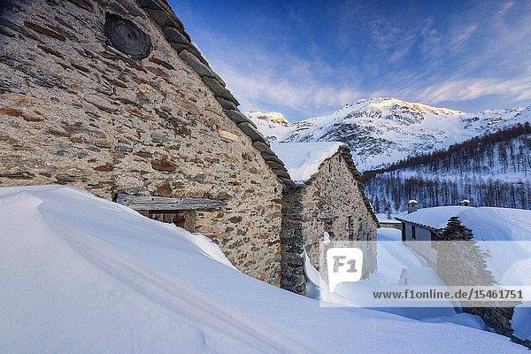 Stone huts covered with snow  Alpe Groppera  Madesimo  Valchiavenna  Valtellina  Sondrio province  Lombardy  Italy.