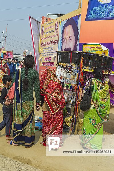 Pilgrims under giant posters  Allahabad Kumbh Mela  World's largest religious gathering  Uttar Pradesh  India.