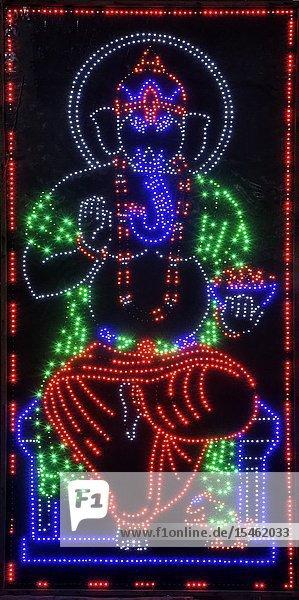 Illuminated representation of Lord Ganesha during the night  Allahabad Kumbh Mela  World's largest religious gathering  Uttar Pradesh  India.