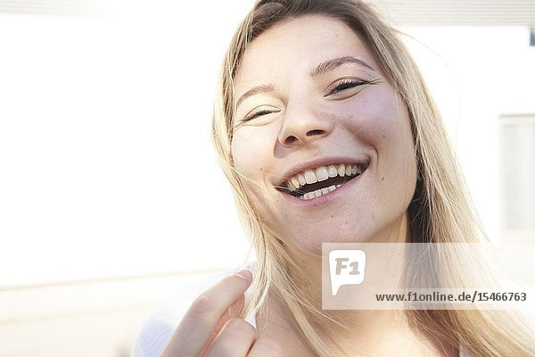 Buoyant woman laughing  happy