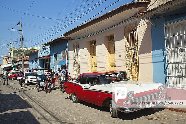 Local people in front of the colonial houses at the town center  Trinidad  Sancti Spiritu Province  Cuba  West Indies  Central America