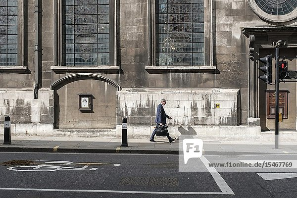 City of London England-city worker running late for work in the financial district.
