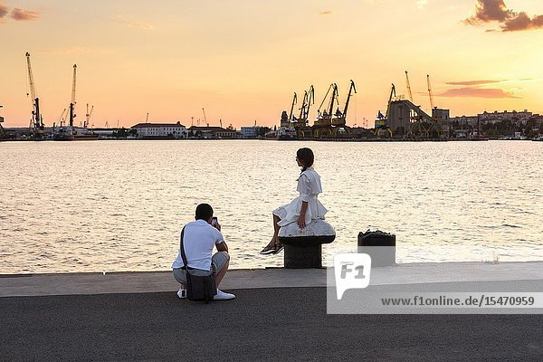 Young couple taking photos   Port of Burgas  Bulgaria.