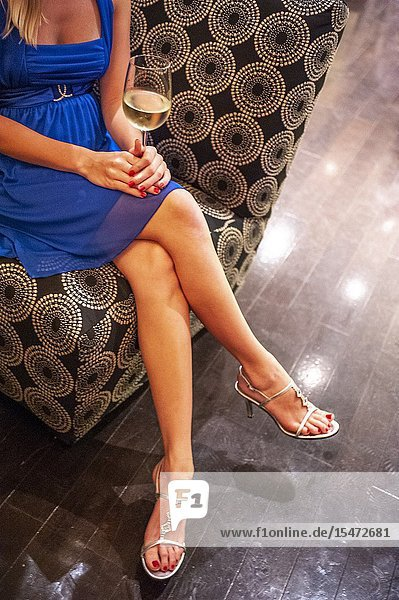 Partial view of a woman's bare legs seated in a restaurant..