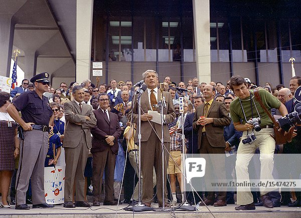USA Hunstville -- 24 Jul 1969 -- Apollo 11 splashdown celebration in Huntsville  Alabama  on July 24  1969. Huntsville Alabama is the home of the Marshall Space Flight Center which developed the Saturn vehicles under the direction of Dr. von Braun. The photo shows Dr. von Braun speaking to the crowd at the Madison County Courthouse as Mayor Joe Davis  Madison County Commissioner James Record and City Council President Ken Johnson look on -- Picture by Lightroom Photos / NASA.
