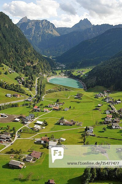 Austria: Paragliding above the village St. Gallenkirchen in the Zillertal Valley in Tirol's mountains.