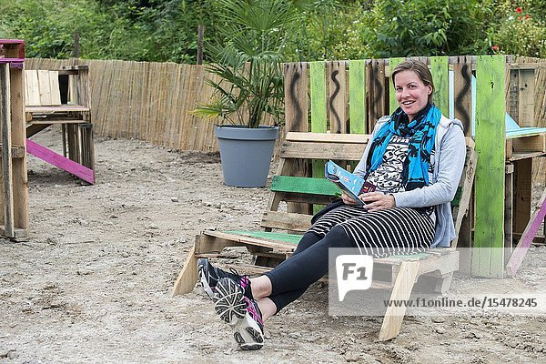 Tilburg  Netherlands. Young  female visitor to Festival Mundial 2016 realaxing in one of the attractions on the festival's grounds.