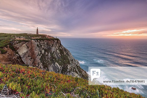 Sunset on the cape and lighthouse of Cabo da Roca overlooking the Atlantic Ocean Sintra Portugal Europe.