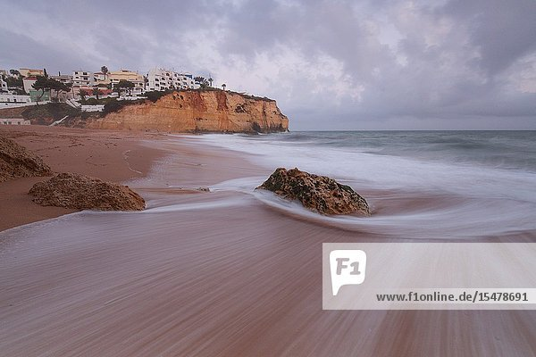 View of Carvoeiro village surrounded by sandy beach and clear sea at dusk Lagoa Municipality Algarve Portugal Europe.