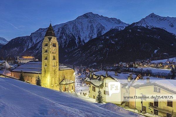 Central street and San Pantaleone Church at dusk  Courmayeur  Aosta Valley  Italy.