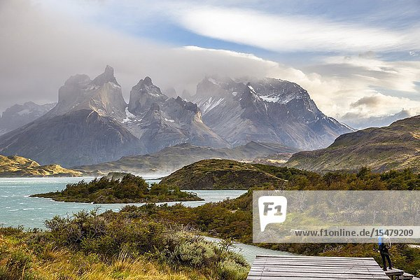 Chile Patagonia Magallanes and Chilean Antarctica Region Ultima Esperanza Province Torres del Paine National Park a man admires the Paine Horns.