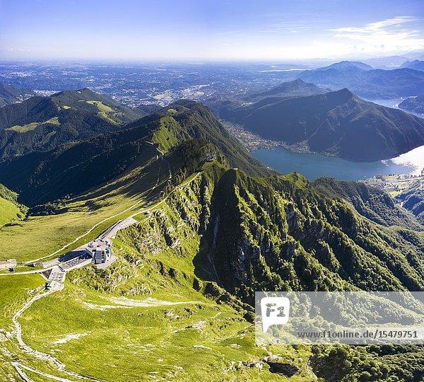 Aerial view of the Monte Generoso and Mario Botta's Fiore di Pietra restaurant on the top of the mountain. Rovio  Lake Ceresio  Canton Ticino  Switzerland.