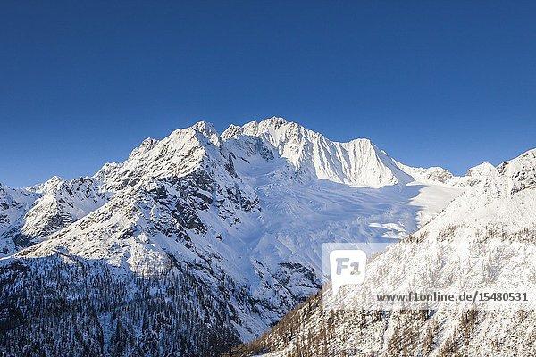 Sunrise on the snowy peak of Monte Vazzeda  Alpe dell'Oro  Valmalenco  Valtellina  Sondrio province  Lombardy  Italy.