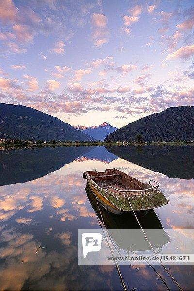 Boat moored in lake of Novate Mezzola at sunrise  Valchiavenna  Sondrio province  Valtellina  Lombardy  Italy.