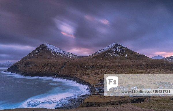 Ocean waves crashing on cliffs around Gjogv  Eysturoy island  Faroe Islands  Denmark.