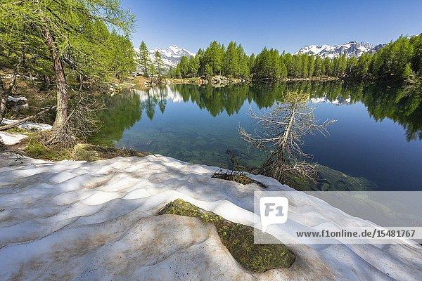 Snow on the shore of Lago Azzurro during spring  Motta  Madesimo  Valle Spluga  Valtellina  Sondrio province  Lombardy  Italy.