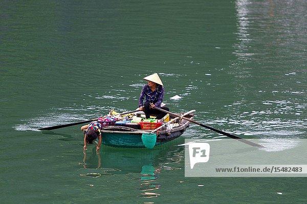 Woman selling products  Ha Long Bay  Quang Ninh Province  Vietnam  Asia.