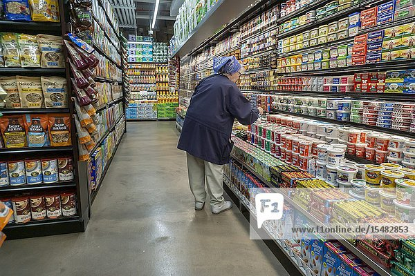 A Senior Citizen peruses the dairy department in a supermarket in New York on Thursday,  May 2,  2019. (© Richard B. Levine).