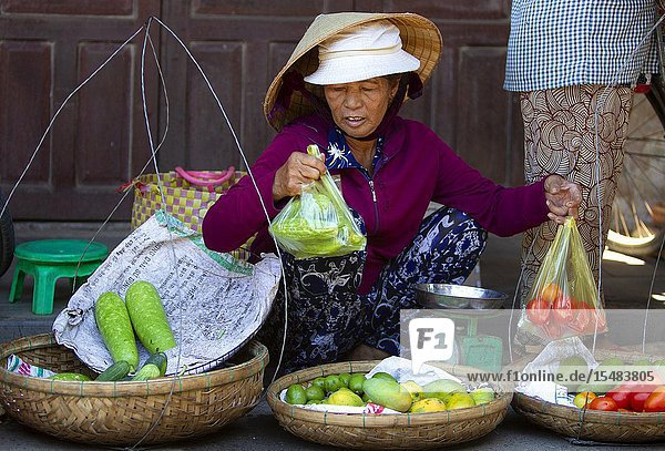 Woman selling vegetables on the fresh food market of Hoi An Old Town  Vietnam  Southeast Asia.