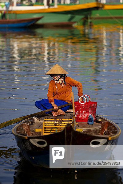 Woman in boat on the Thu Bon River. Hoi An Ancient Town  Quang Nam Province  Vietnam.