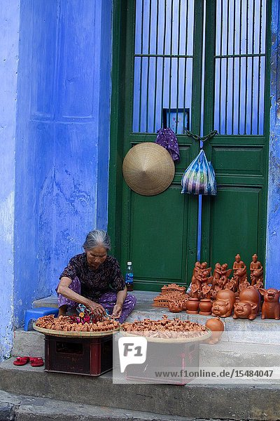 Vender in the street. Hoi An Ancient Town  Quang Nam Province  Vietnam..