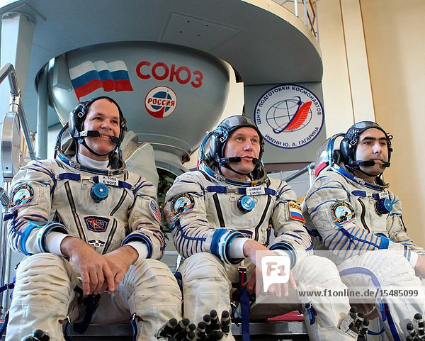 At the Gagarin Cosmonaut Training Center in Star City  Russia  NASA astronaut Kevin Ford (left)  Expedition 33 flight engineer and Expedition 34 commander  Soyuz Commander Oleg Novitskiy (center) and Flight Engineer Evgeny Tarelkin (right) answer questions from reporters in front of a Soyuz vehicle mock-up during the second day of final qualification exams Sept. 21  2012. The exams will lead to their launch scheduled for Oct. 23 in the Soyuz TMA-06M spacecraft from the Baikonur Cosmodrome in Kazakhstan for a five-month stay on the International Space Station.