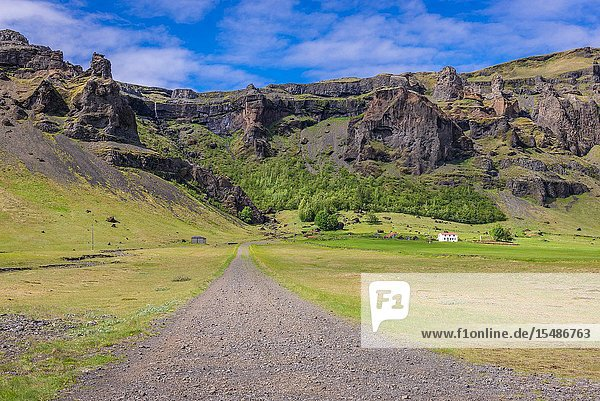 Farm among rocky hills in south part of Iceland.