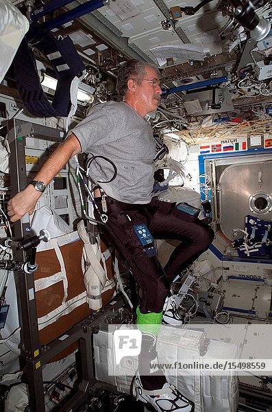 Astronaut John L. Phillips  Expedition 11 NASA Space Station science officer and flight engineer  uses the Cycle Ergometer with Vibration Isolation System (CEVIS) while participating in the FootGround Reaction Forces During Spaceflight (FOOT) experiment in the Destiny laboratory of the International Space Station. Phillips wore the specially instrumented Lower Extremity Monitoring Suit (LEMS)  cycling tights outfitted with sensors  during the experiment.