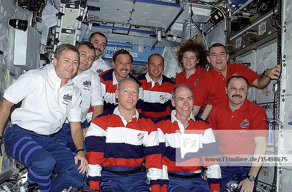 The Expedition Three (white shirts)  STS-105 (striped shirts)  and Expedition Two (red shirts) crews assemble for a press conference in the U.S. Laboratory. The Expedition Three crew members are  from front to back  Frank L. Culbertson  mission commander  and cosmonauts Vladimir N. Dezhurov and Mikhail Tyurin  flight engineers  STS-105 crewmembers are  front row  Patrick G. Forrester and Daniel T. Barry  mission specialists  and back row  Scott J. Horowitz  commander  and Frederick W. (Rick) Sturckow  pilot  Expedition Two crewmembers are  from front to back  cosmonaut Yury V. Usachev  mission commander  and James S. Voss and Susan J. Helms  flight engineers. This image was taken with a digital still camera.