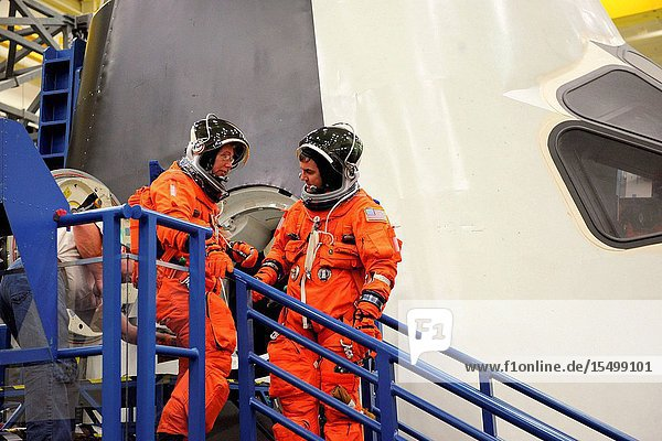 NASA astronauts Sandy Magnus and Rex Walheim  both STS-135 mission specialists  attired in training versions of the shuttle launch and entry suit  participate in an ingressegress training session in a shuttle mock-up in the Space Vehicle Mock-up Facility at NASA's Johnson Space Center.