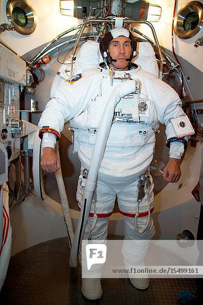 Cosmonaut Sergei K. Krikalev  Expedition 11 commander representing Russia's Federal Space Agency  participates in an Extravehicular Mobility Unit (EMU) spacesuit fit check in a Space Station Airlock Test Article (SSATA) in the Crew Systems Laboratory at the Johnson Space Center (JSC).